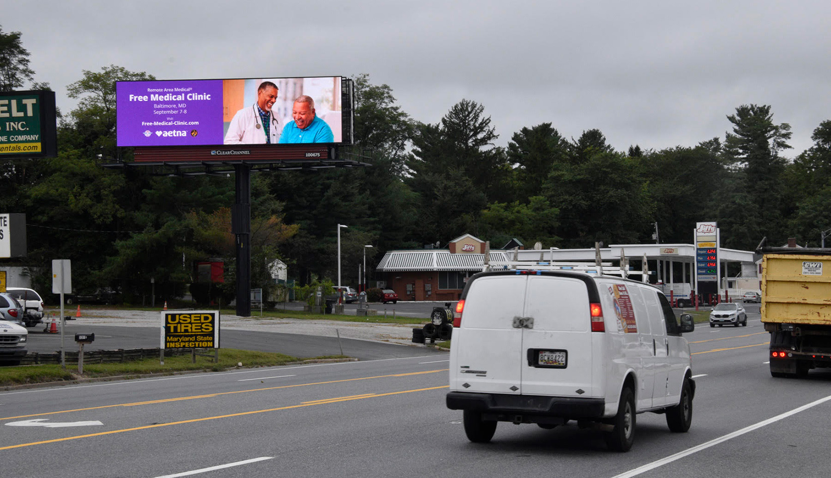 Remote Area Medical digital billboard showing free medical clinic information